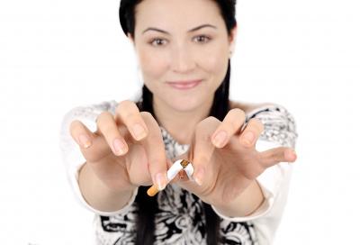 woman breaking a cigarette stick