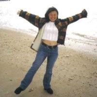 Girl in the beach very happy