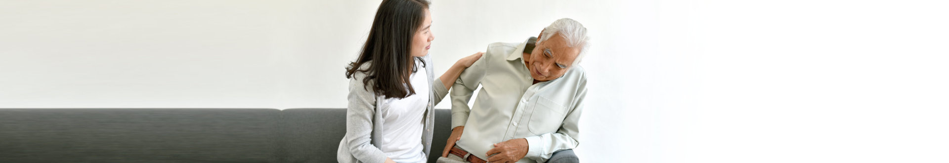 senior man in pain with senior woman on his side