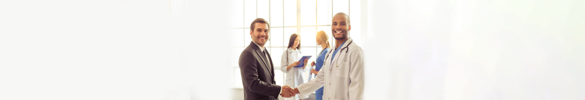 doctor shaking hands with a businessman